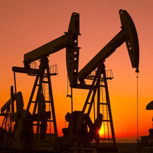 Photo of Oil Wells at Sunset